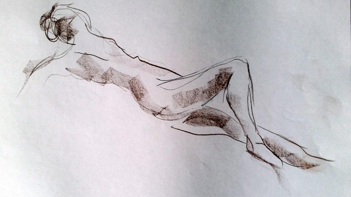 Krokiskiss med brun krita på vitt papper