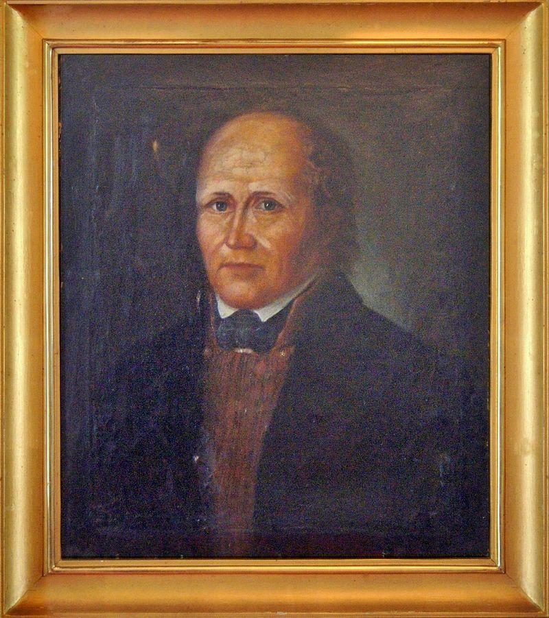 Porträtt av en man.